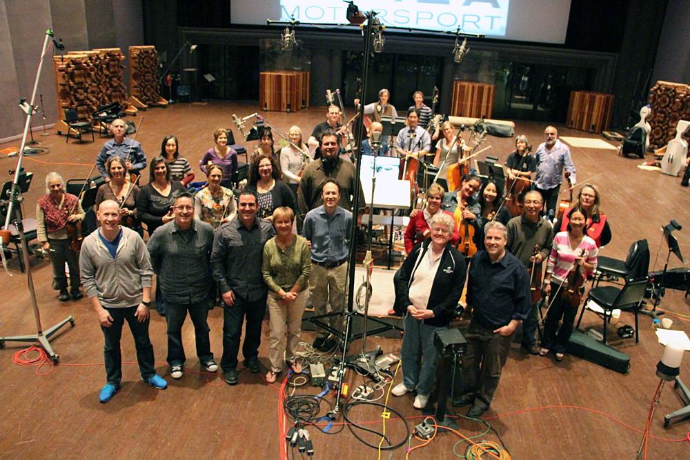 On the sound stage at Skywalker Ranch tracking strings for the Forza Motorsport 5 soundtrack. Front row: Chase Combs, John Broomhall, Paul Lipson, Janet Ketchum, Lennie Moore, Leslie Ann Jones, Lance Hayes. Subsequent rows: Marco D'Ambrosio and the Skywalker Symphony strings